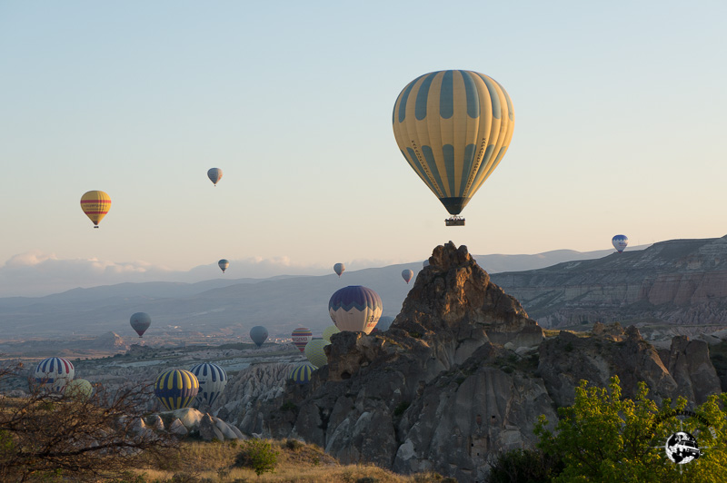 Hot air balloons rising out of the valley in Capadocia, Turkey.